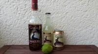 Zutaten für den Dark 'N' Stormy: Gosling's Black Seal Bermuda Rum, (Gosling's) Ginger Beer und eine Limette.