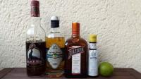 Zutaten für den Royal Bermuda Yacht Club: Bermuda Rum, Falernum, Cointreau (Triple Sec), Angostura Bitters und eine Limette.