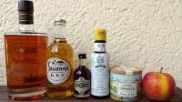 Zutaten für den Remember Maine: gereifter Martinique-Rum, Cider, Pimento Dram, Angostura Bitters, Fleur de Sel und ein Apfel.
