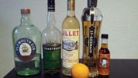 Zutaten für den Albert Mathieu: Gin, Chartreuse Verte, Lillet Blanc, St. Germain, Orange Bitters und eine Orange.